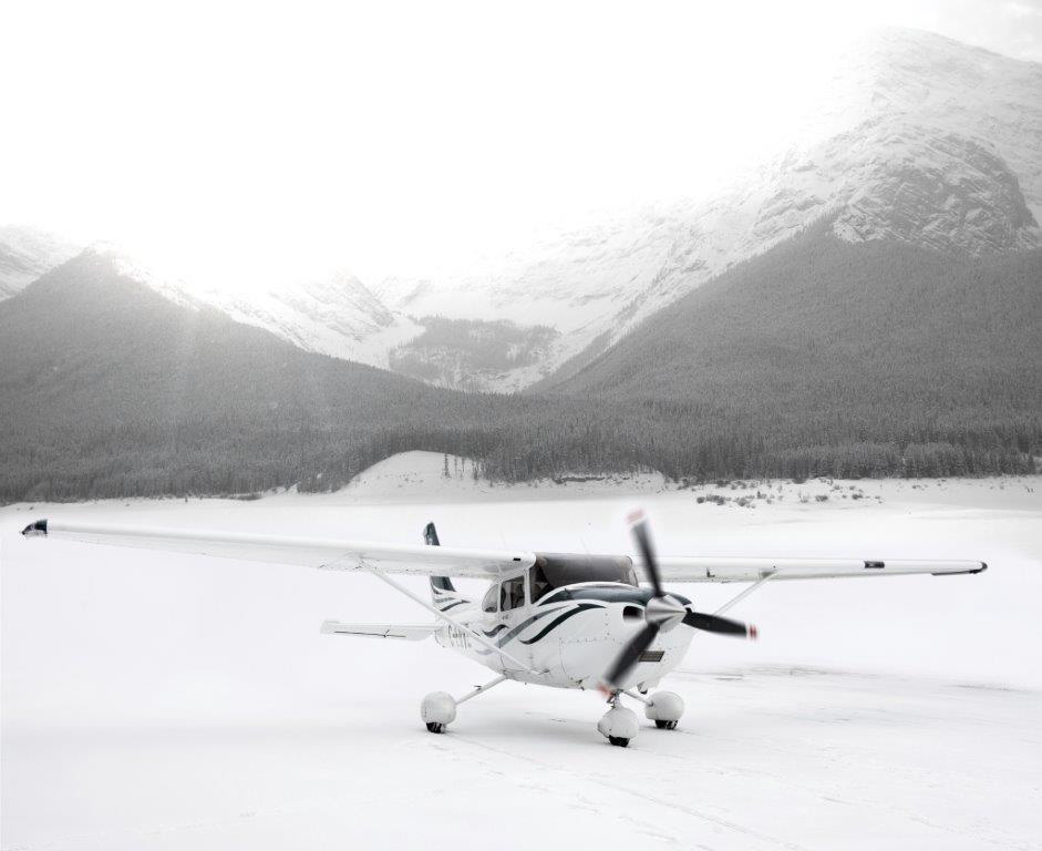 white airplane in snow